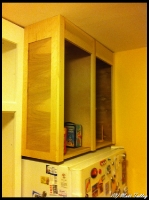 huge cabinet above fridge