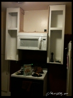 two cabinets and microwave installed