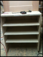 Here is the shoe rack before the face frame was installed.  You can see where I dadoed the shelves into the panels.