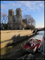 Notre-Dame, the Seine, and a tour boat as seen from the edge of the Latin Quarter
